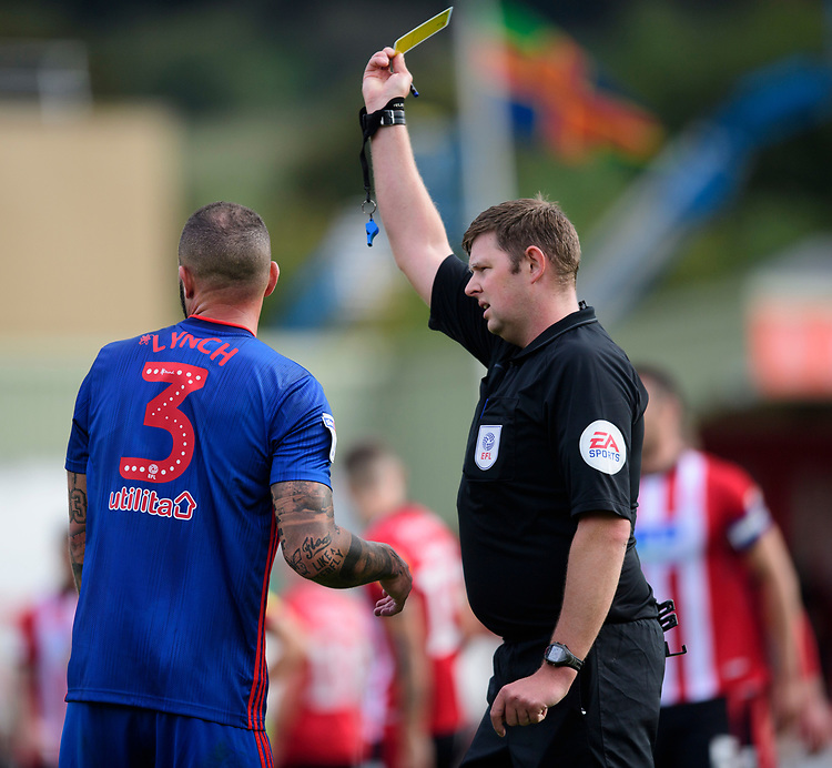 Sunderland's Joel Lynch is shown a yellow card by referee Brett Huxtable<br /> <br /> Photographer Chris Vaughan/CameraSport<br /> <br /> The EFL Sky Bet League One - Lincoln City v Sunderland - Saturday 5th October 2019 - Sincil Bank - Lincoln<br /> <br /> World Copyright © 2019 CameraSport. All rights reserved. 43 Linden Ave. Countesthorpe. Leicester. England. LE8 5PG - Tel: +44 (0) 116 277 4147 - admin@camerasport.com - www.camerasport.com
