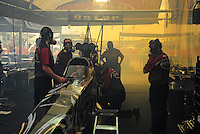 Apr. 29, 2012; Baytown, TX, USA: Nitro fumes fill the pit area of NHRA top fuel dragster driver Khalid Albalooshi as he warms up the car during the Spring Nationals at Royal Purple Raceway. Mandatory Credit: Mark J. Rebilas-