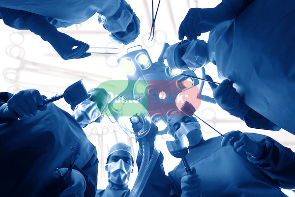 dramatic worms-eye-view from patient's perspective of surgical team gathered around operating table, blue duotone