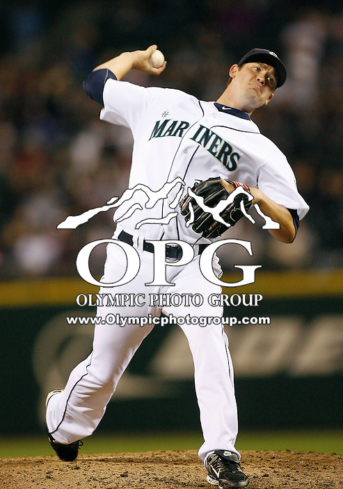16 April 2010: Seattle Mariners relief pitcher Sean White fires the ball to the plate against the Detroit Tigers.  All coaches and players in the game had the number #42 as their jersey number during the game to help commemorate baseball's Jackie Robinson Day.  Seattle won 11-3 over Detroit at Safeco Field in Seattle, Washington.