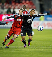 16 April 2011: D.C. United forward Charlie Davies #9 and Toronto FC defender Ty Harden #20 in action during an MLS game between D.C. United and the Toronto FC at BMO Field in Toronto, Ontario Canada..D.C. United won 3-0.