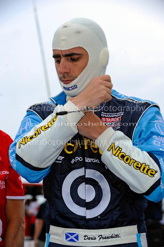25-26 April, 2009, Kansas City, Kansas, USA.Dario Franchitti (Edinburgh, Scotland) suits up for qualifying..©F. Peirce Williams 2009 USA.ref: RAW (.NEF) image available