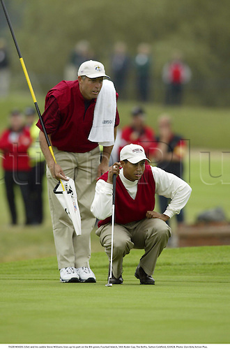 TIGER WOODS (USA) and his caddie Steve Williams lines up his putt on the 8th green, Fourball Match, 34th Ryder Cup, The Belfry, Sutton Coldfield, 020928. Photo: Glyn Kirk/Action Plus....2002.putts putting.golf golfer player