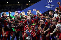 Liverpopol's captain Jordan Henderson, center, preparers to hold up the trophy at the end of the UEFA Champions League final football match between Tottenham Hotspur and Liverpool at Madrid's Wanda Metropolitano Stadium, Spain, June 1, 2019. Liverpool won 2-0.<br /> UPDATE IMAGES PRESS/Isabella Bonotto