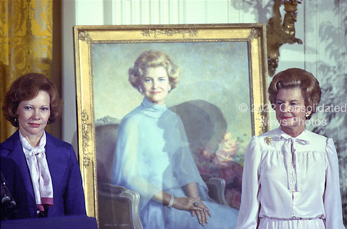 "First lady Rosalynn Carter, left, and former first lady Betty Ford pose next to the portrait of Mrs. Ford that was unveiled during a ceremony in the East Room of the White House in Washington, DC on August 4, 1980. The painting will be on permanent display at the White House along with those of other US Presidents and first ladys.  <br /> Credit: Benjamin E. ""Gene"" Forte / CNP"