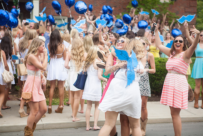 Pi Beta Phi sisters celebrate the arrival of their new members during UK's sorority bid day in Lexington, Ky., on Friday, August 22, 2014. Photo by Adam Pennavaria | Staff