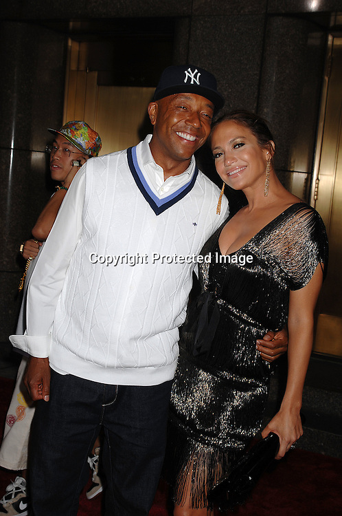 Russell Simmons and Jennifer Lopez..arriving for The Fourth Annual Fashion Rocks concert presented by Conde Nast Media Group on ..September 6, 2007 at Radio City Music Hall. ..Photo by Robin Platzer, Twin Images....212-935-0770