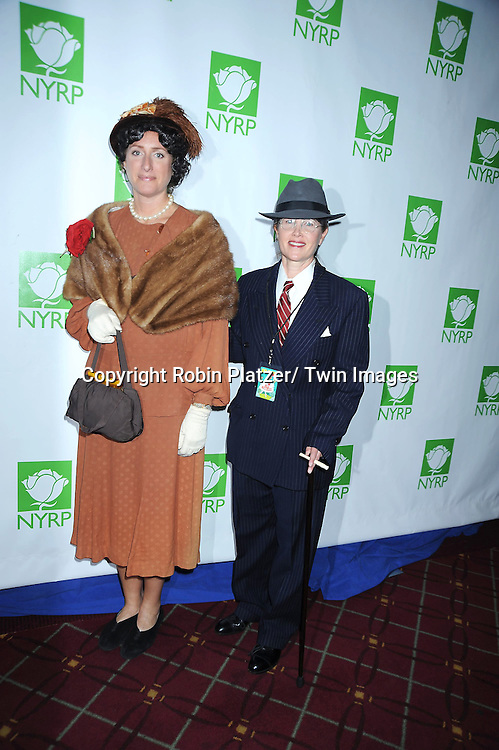 Judy Gold and partner Elysa Halpern attending the 15th Annual  Hulaween Benefit Gala at the Waldorf Astoria Hotel in New York City on October 29, 2010..The gala benefits Bette Midler's New York Restoration Project.
