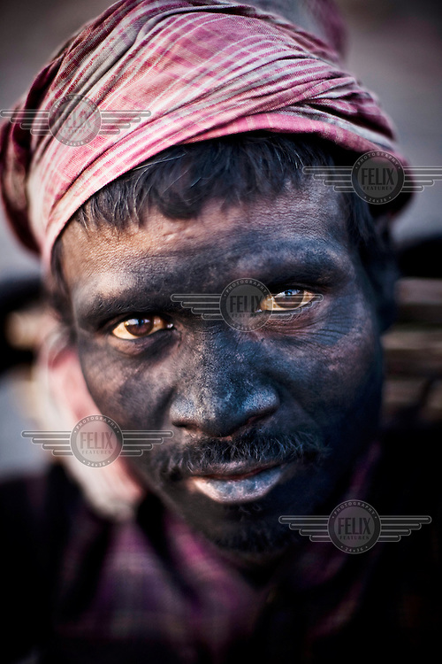Mathura Bhuia works for about 10 hours a day, earning 150 Indian Rupees (3.5USD), loading coal trucks in the BCCL (Bharat Coking Coal Limited) coal mines.