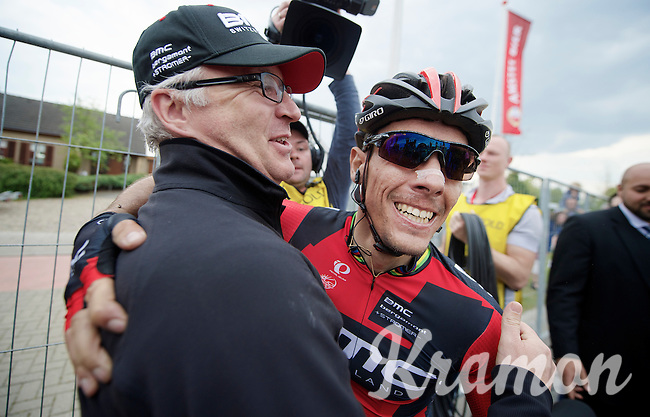 big smile for race winner Philippe Gilbert (BEL/BMC) who falls into the arms of team press officer Georges Lüchinger straight after the finish line<br /> <br /> Amstel Gold Race 2014