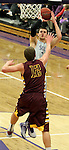 SIOUX FALLS, SD - JANUARY 30:  Mack Johnson #3 from the University of Sioux Falls spots up for a jumper over Reece Zoelle #12 from Minnesota Duluth in the first half of their game Friday night at the Stewart Center.  (Photo by Dave Eggen/Inertia)