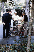 United States President Jimmy Carter, right, interrupts a ride on his bicycle to speak with Foreign Minister Muhammad Ibrahim Kamal of Egypt, left, Deputy Premier Hassan Tohami of Egypt, left center, and Ahmed Maher El Sayed, advisor to FM Kamal at Camp David, near Thurmont, Maryland on September 12, 1978..Credit: White House via CNP