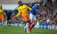 Gozie Ugwu of Wycombe Wanderers  & Christian Burgess of Portsmouth  in action during the Sky Bet League 2 match between Portsmouth and Wycombe Wanderers at Fratton Park, Portsmouth, England on 23 April 2016. Photo by Andy Rowland.