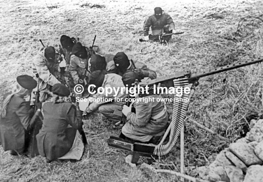 This republican movement press release photograph claims to be of a Provisional IRA border unit on manoeuvres in Co Fermanagh, N Ireland, February 1977.  The men and women volunteers are seen using a variety of weapons i.e. a 50 mm Browning machine gun, a 30 mm machine gun and other automatic weapons. 197702130024b<br />