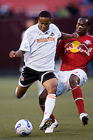 Red Bulls forward (9) Jean Philippe Peguero attempts a tackle on Houston Dynamo midfielder (13) Ricardo Clark. The Red Bulls and the Dynamo played to a 1-1 tie at Giants Stadium, East Rutherford, NJ, on June 10, 2006.