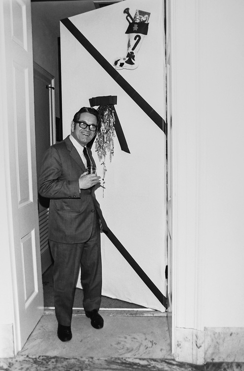 Congressman standing outside decorated office door around Christmas. (Photo by Dev O'Neill/CQ Roll Call via Getty Images)