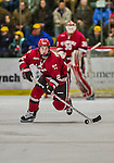 14 December 2013: Saint Lawrence University Saint Defenseman Eric Sweetman, a Freshman from Woodbine, MD, in third period action against the University of Vermont Catamounts at Gutterson Fieldhouse in Burlington, Vermont. The Catamounts defeated their former ECAC rivals, 5-1 to notch their 5th straight win in NCAA non-divisional play. Mandatory Credit: Ed Wolfstein Photo *** RAW (NEF) Image File Available ***