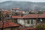 Rooftops of houses wet day in winter, village of Shipka, Bulgaria, eastern Europe