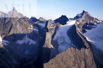 Arrigetch Peaks, Gates of the Arctic National Park, Alaska. Glacial remnants fill high cirques between granite walls.