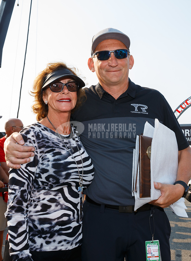 Sep 4, 2017; Clermont, IN, USA; Kay Torrence (left) mother of NHRA top fuel driver Steve Torrence during the US Nationals at Lucas Oil Raceway. Mandatory Credit: Mark J. Rebilas-USA TODAY Sports