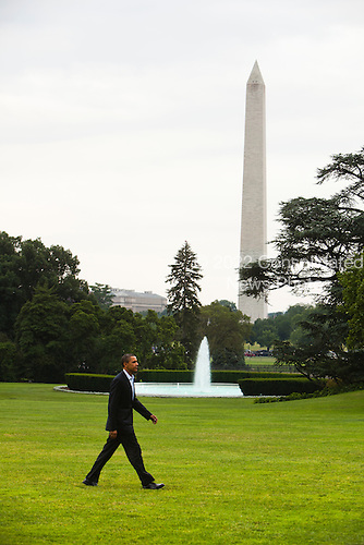 United States President Barack Obama walks across the South Lawn returns to the White House after a two-day trip to the Gulf Coast, and shortly before giving his first national address from the Oval Office to confront the gulf oil crisis, in Washington DC, USA, on Tuesday, June 15, 2010..Credit: Jim Lo Scalzo - Pool via CNP