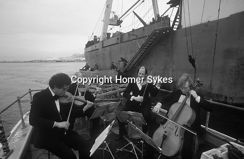 Ullapool Scotland. 1986. Loch Broom, the Edinburgh String Quartet playing to a Bulgarian factory fishing boat.