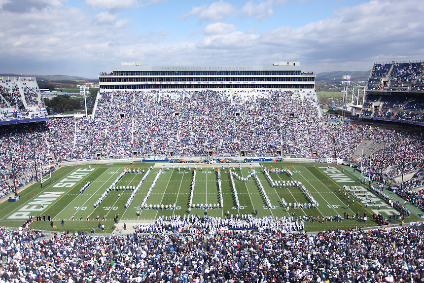 "State College, PA - 10/15/2011:  The Penn State Alumni Blue Band spelled ""Alums"" as a formation on the field during halftime of the homcoming game.  Penn State defeated Purdue by a score of 23-18 on October 15, 2011, homecoming, at Beaver Stadium...Photo:  Joe Rokita / JoeRokita.com..Photo ©2011 Joe Rokita Photography"