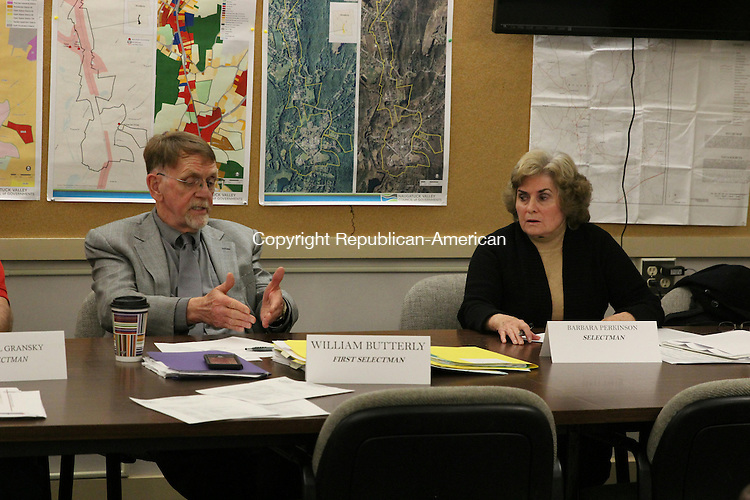 WOODBURY, CT: 14 Dec. 2015: 12142015CB01: WOODBURY -- First Selectman William J. Butterly, left, and Selectman Barbara K. Perkinson hold a discussion last week about the dismissal of an ad hoc committee tasked with the study of the purchase of property owned by the Aquarion Water Co. Caleb Bedillion Republican-American