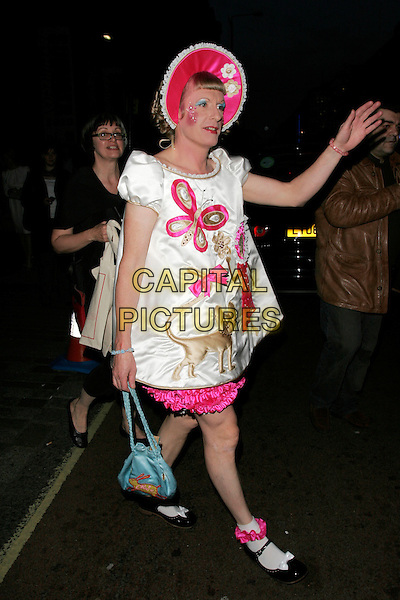 GRAYSON PERRY.Leaving The Royal Academy of Arts Summer Exhibition 2008 preview party at Royal Academy of Arts in London, England..June 4th, 2008.full length dressed up as little girl pink white dress dolly socks shoes mary janes make-up hat bonnet cross dresser blue bag purse hand.CAP/AH.©Adam Houghton/Capital Pictures.