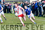 An Ghaeltacht Marc Ó Sé in an action closely watched by Templenoe Will Sheehy during the County League match at Gallarus on Sunday afternoon.