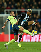 9th November 2019; St James Park, Newcastle, Tyne and Wear, England; English Premier League Football, Newcastle United versus AFC Bournemouth; Joelinton of Newcastle United controls the ball under heavy pressure from Steve Cook of AFC Bournemouth - Strictly Editorial Use Only. No use with unauthorized audio, video, data, fixture lists, club/league logos or 'live' services. Online in-match use limited to 120 images, no video emulation. No use in betting, games or single club/league/player publications