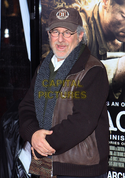 "STEVEN SPEILBERG.Attending the Los Angeles Premiere of HBO's ""The Pacific"" held at Grauman's Chinese Theater, Hollywood, California, USA, 24th February 2010 .half length leather jacket brown cap hat beard facial hair glasses scarf knitted green grey gray mouth open .CAP/ADM/TC.©T. Conrad/AdMedia/Capital Pictures."