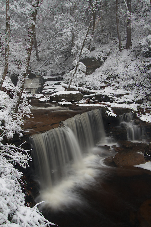 Delaware Falls at Ricketts Glen park after the first snow fall of winter blankets the forest