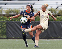 Boston College forward Rachel Davitt (24) clears the ball as Pepperdine University forward Lynn Williams (25) closes. Pepperdine University defeated Boston College,1-0, at Soldiers Field Soccer Stadium, on September 29, 2012.