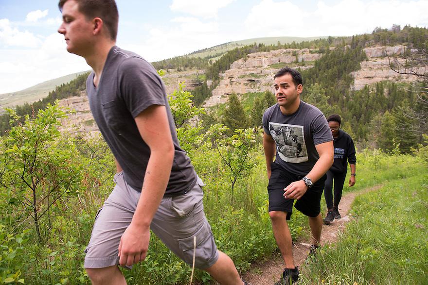 Hikers explore Sluice Boxes State Park near Belt, Montana.