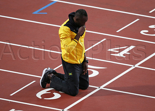 August 13th 2017, London Stadium, East London, England; IAAF World Championships, Day 10; Usain Bolt of Jamaica with a prayer on the finishing line during a final lap of honour around the track