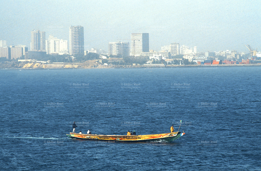 Senegal. Dakar. View from Goree island. The island is half an hour distant from Dakar by boat.. A fishermen motorboat sails on the atlantic ocean . © 2000 Didier Ruef