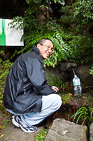 Gathering natural spring water at the source of Mt Tsukuba.  Rather the waste endless plastic bottles for mineral water or drinking water, it is becoming increasingly popular to re-use water bottles by refilling them at the source.