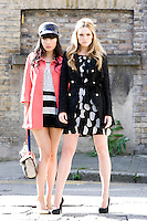 NO REPRO FEE.30/8/2010. AWEAR AUTUMN COLLECTION. Yomiko Chen & Sarah Morrissey model a selection of dresses from A|wear's new autumn '10 collection in Dublin. Sarah wears Monochrome petal shift dress - EUR50 Black coat - EUR80 .Yomiko Chen wears Lace shift dress - EUR40 Coral bow coat - EUR50 Peak cap - EUR15.  The collection arrives instore and onwww.awear.comfrom this week. Picture James Horan/Collins Photos