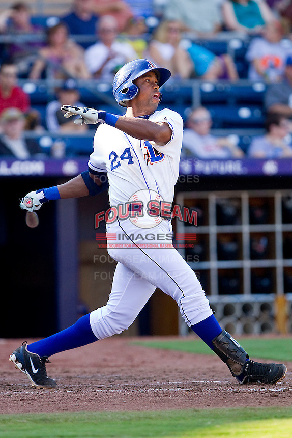 Leslie Anderson #24 of the Durham Bulls follows through on his swing against the Charlotte Knights at Durham Bulls Athletic Park on August 28, 2011 in Durham, North Carolina.   (Brian Westerholt / Four Seam Images)