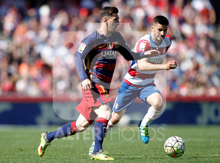 Granada's Fran Rico (r) and FC Barcelona's Leo Messi during La Liga match. May 14,2016. (ALTERPHOTOS/Acero)