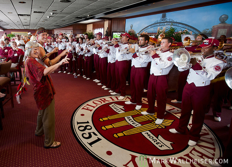 Molly Barron leads the Florida State University band in the president's box at Doak S Campbell Stadium as FSU defeated Wake Forest 52-0 on Bobby Bowden Fieldin Tallahassee, Florida September 15, 2012.