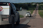 Cheapside Road in Dewitt County, Texas bears significant damage left by heavy truck traffic from nearby oilfield operations. July 25, 2012. Lance Rosenfield / Prime