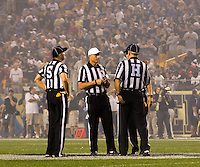 ACC football officials huddle before the game. Florida State defeated Pitt 41-13 at Heinz Field on September 2, 2013.