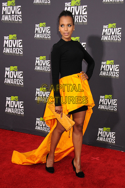 Kerry Washington.2013 MTV Movie Awards - Arrivals held at Sony Pictures Studios, Culver City, California, USA..14th April  2013.full length black top dress yellow skirt train long sleeves shoes hand on hip clutch bag.CAP/ADM/BP.©Byron Purvis/AdMedia/Capital Pictures