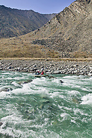 Whitewater rafting, overflow ice on the Kongakut river, Brooks range mountains, Arctic National Wildlife Refuge, Alaska