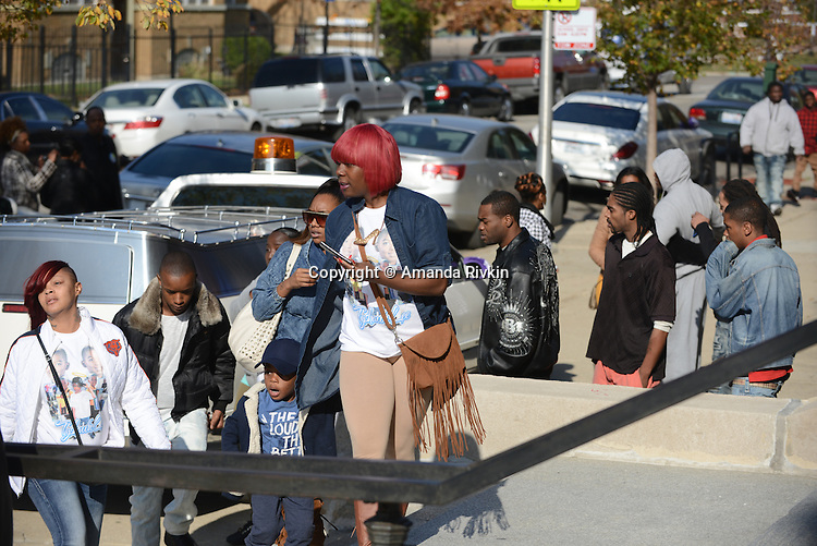 Mourners arrive, including a young friend who reacts to seeing the hearse of Tyshawn Lee, 9, who was shot multiple times while playing basketball in an alley on November 2, 2015, at St. Sabina's in Chicago, Illinois on November 10, 2015. Police allege the killing was a retaliatory gang hit which would mark a new turn in Chicago's gang wars.