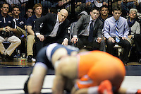 STATE COLLEGE, PA - FEBRUARY 16: Head coach Cael Sanderson and his brother and assistant head coach Cody Sanderson of the Penn State Nittany Lions watch a bout during a match against the Oklahoma State Cowboys on February 16, 2014 at Rec Hall on the campus of Penn State University in State College, Pennsylvania. Penn State won 23-12. (Photo by Hunter Martin/Getty Images) *** Local Caption *** Cael Sanderson;Cody Sanderson