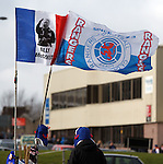 Rangers flag seller sets up before the match