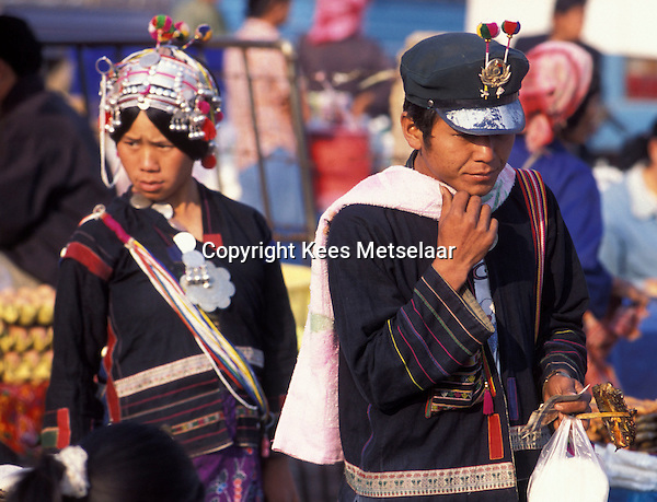 Laos, Luang Namtha Province, Muang sing, 17/3/03..Akha couple at the morning market. They are dressed in their best traditional dress, including the head-dress for the woman...Photo Kees Metselaar